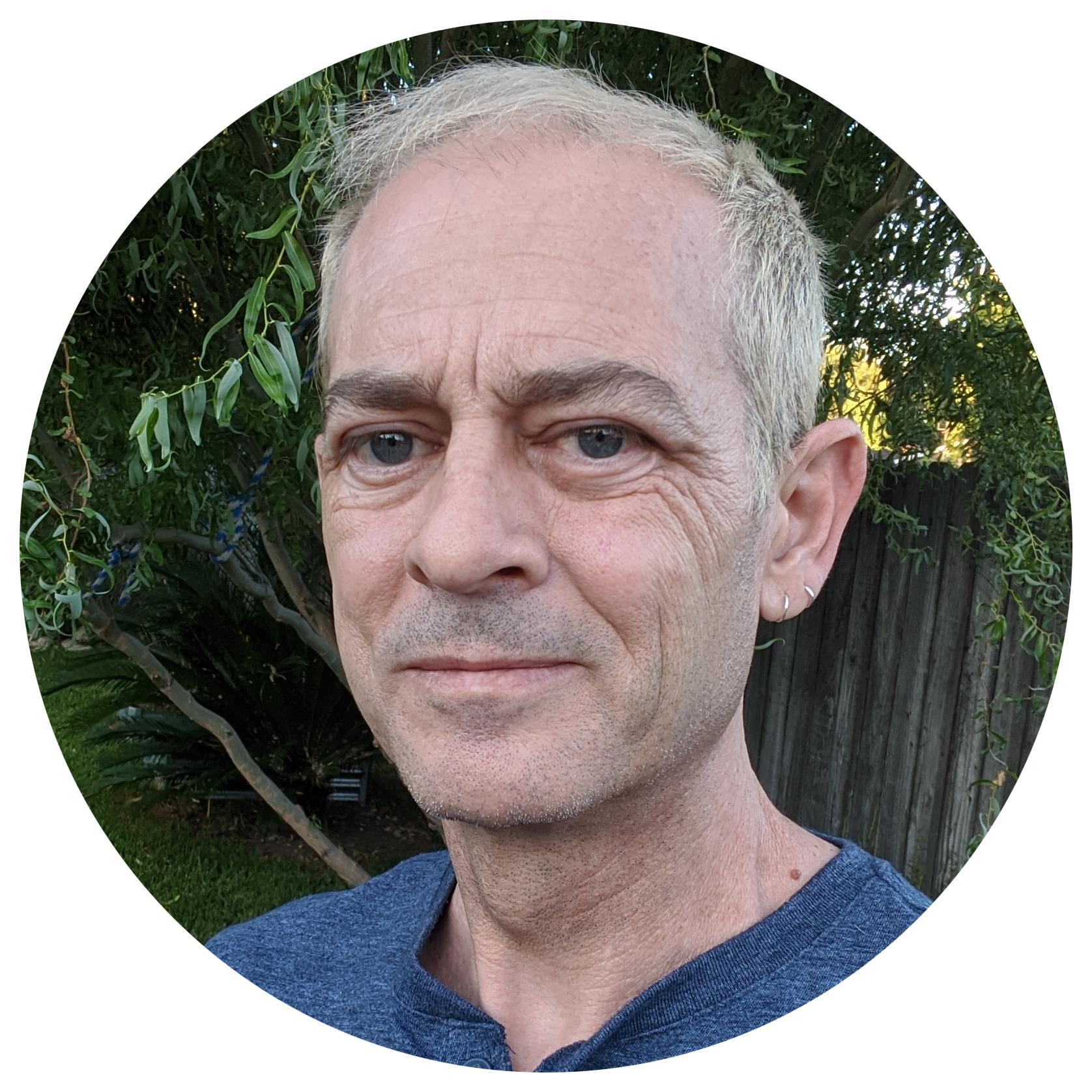 Headshot of Greg Chisholm