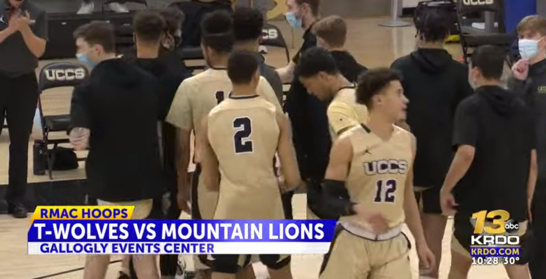 The UCCS men's basketball team after breaking a huddle