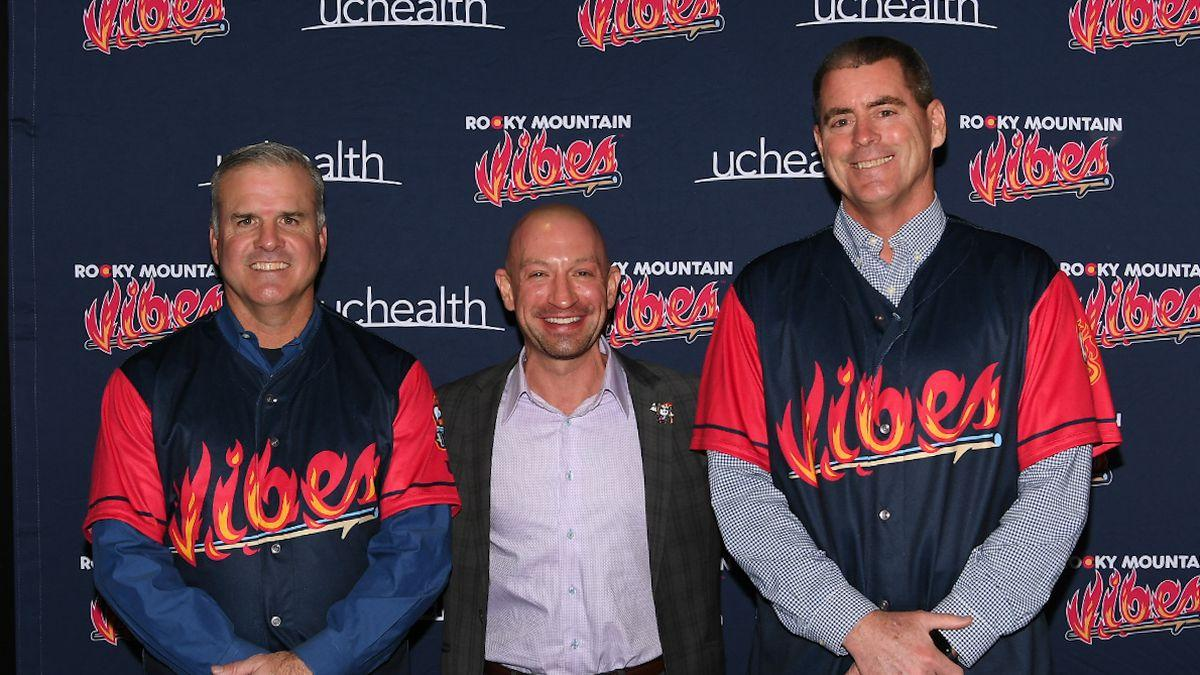 Dave Hajek, Chris Phillips and Mark Lee pose after a Rocky Mountain Vibes press conferece