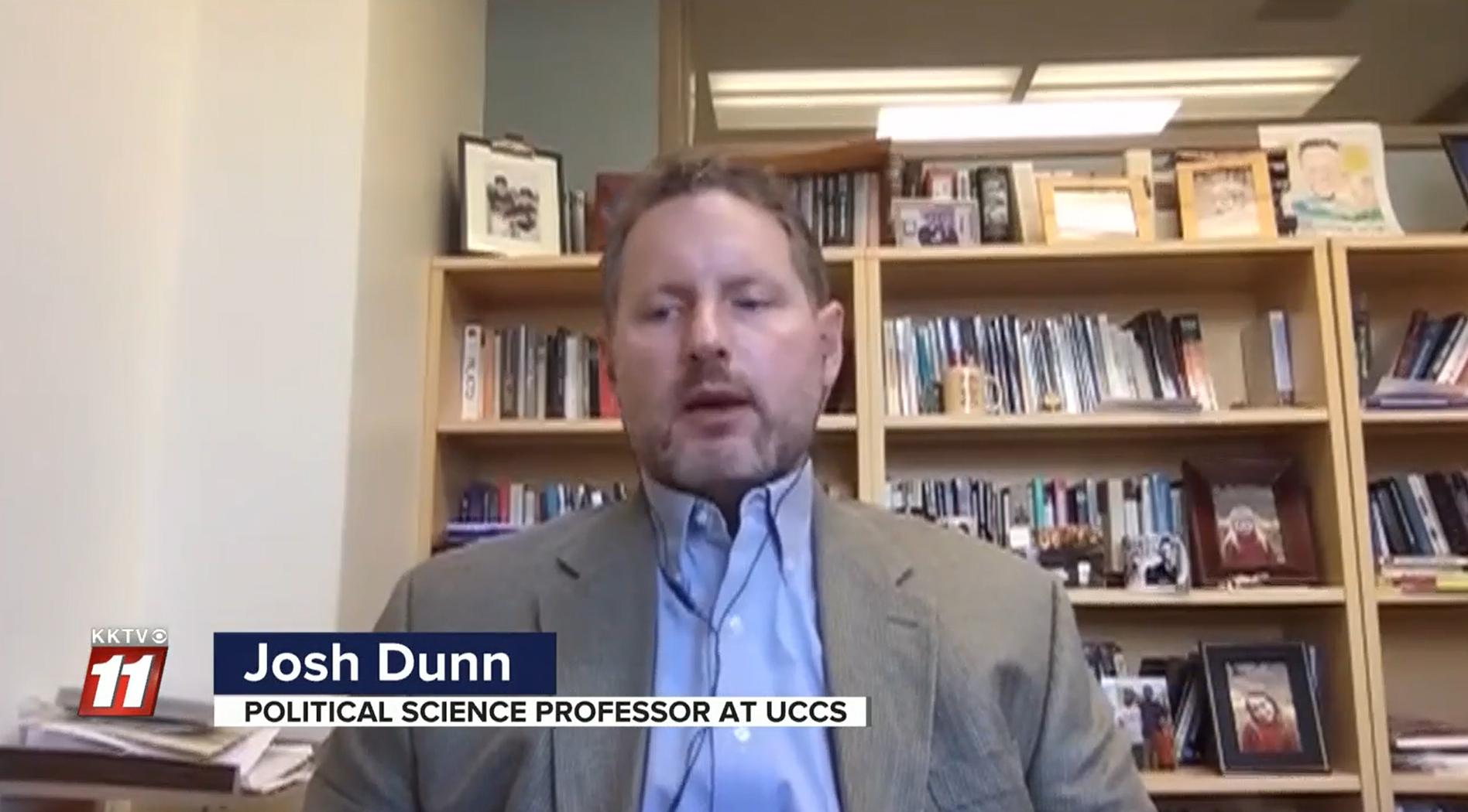 Screenshot of Josh Dunn being interviewed in his office by KKTV