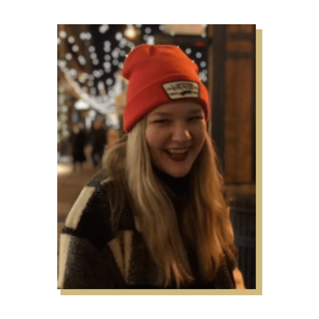 Photo of someone smiling with hat on