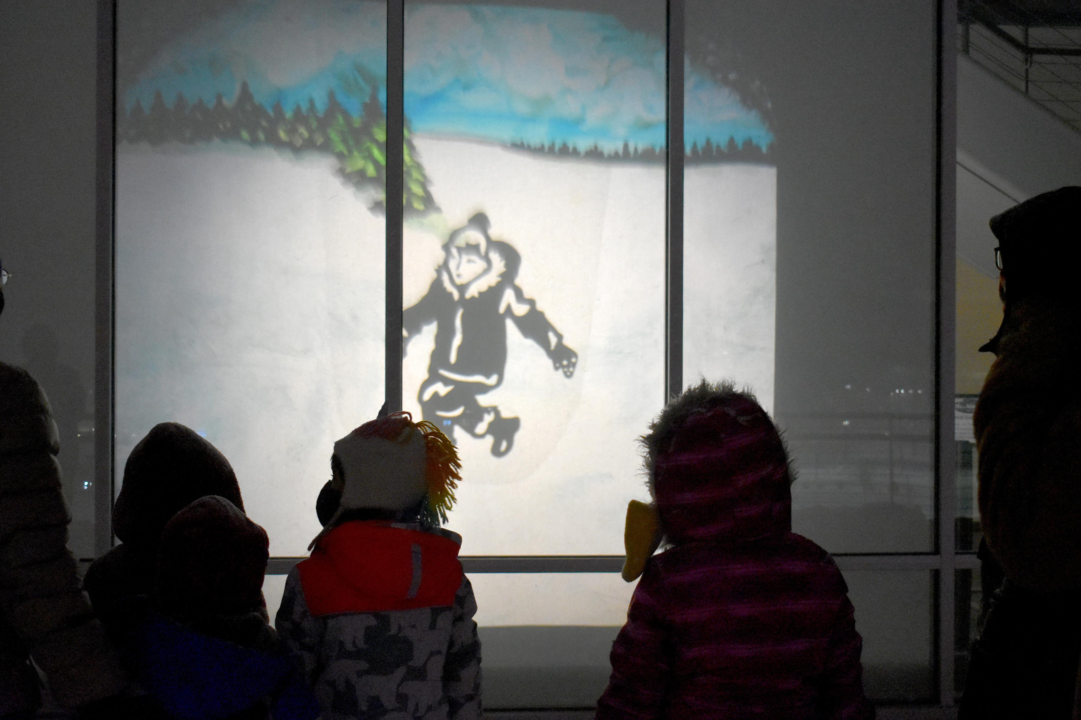 The exterior of the Ent Center for the Arts is turned into a magical forest scene using shadow puppets and overhead projections for the first live Theatreworks production in almost a year.