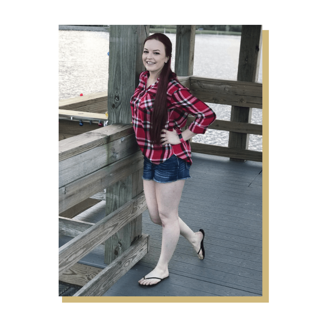 Photo of person smiling, standing on dock