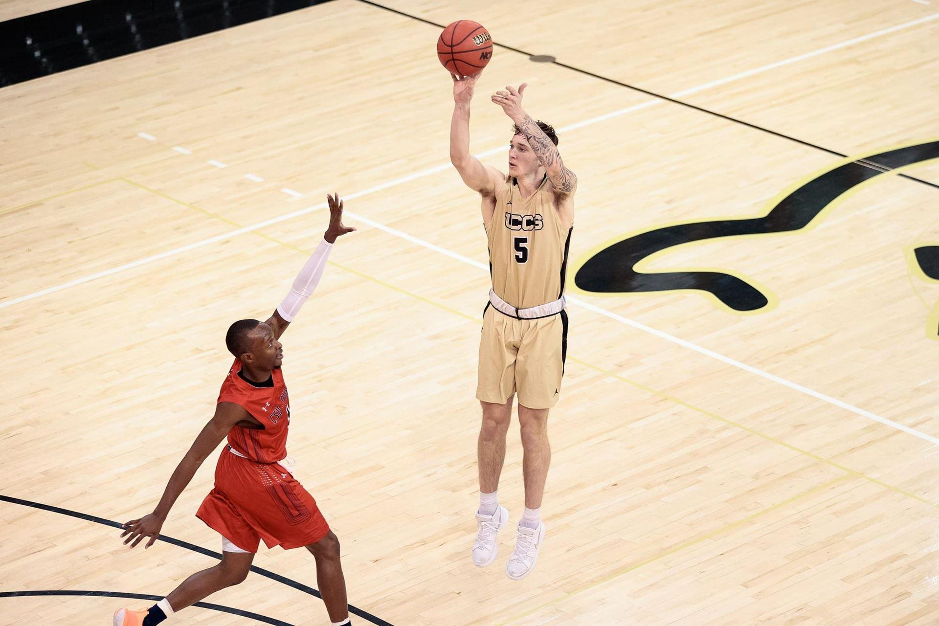 Wyatt Dolberry shooting a three-pointer in Gallogly Events Center
