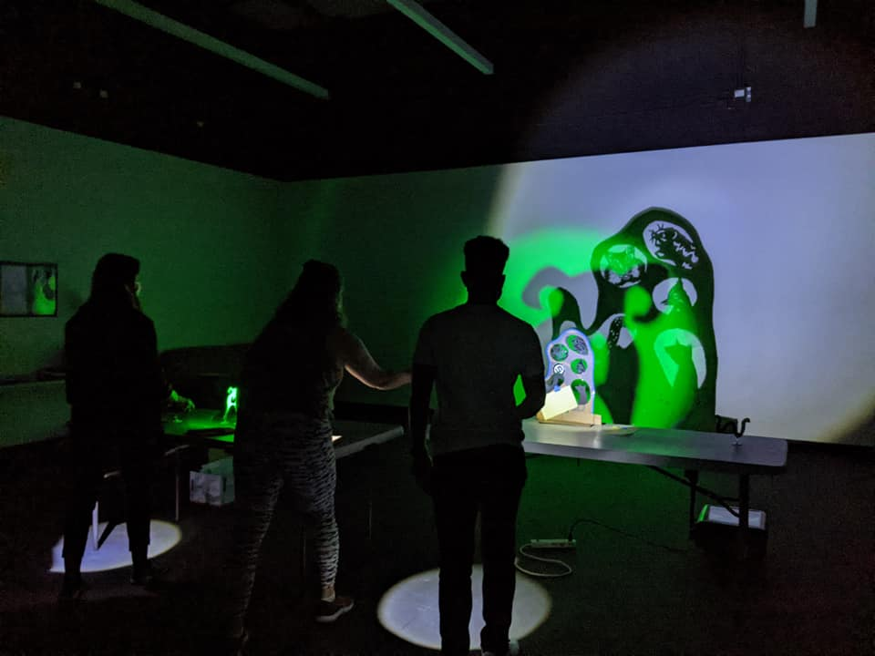 artists make shadow puppets