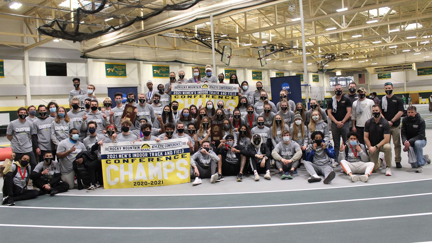track and field champs pose for photos