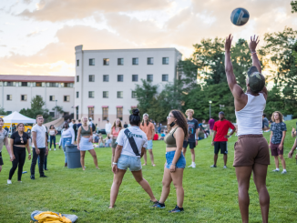 Students playing volleyball and other activities on the West Lawn.